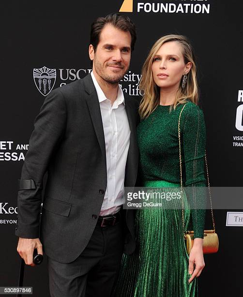 Tennis player Tommy Haas and Sara Foster arrive at the 3rd Biennial Rebels With A Cause Fundraiser at Barker Hangar on May 11 2016 in Santa Monica...