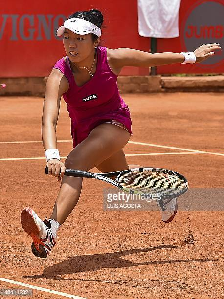 US tennis player Vania King returns the ball to Colombian Mariana Duque during their Bogota Open match in Bogota on April 11 2014 King won 76 and 75...