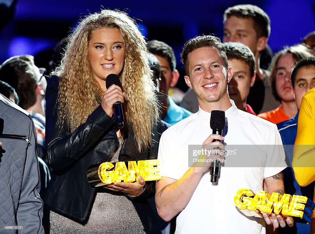 Tennis player Victoria Azarenka and motocross rider Lance Coury speak onstage during Cartoon Network's fourth annual Hall of Game Awards at Barker Hangar on February 15, 2014 in Santa Monica, California.