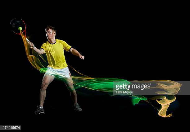 tennis player with ball and light trails
