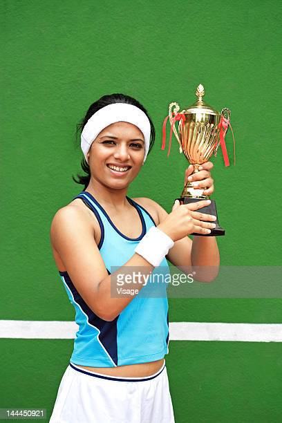 Tennis player with her trophy
