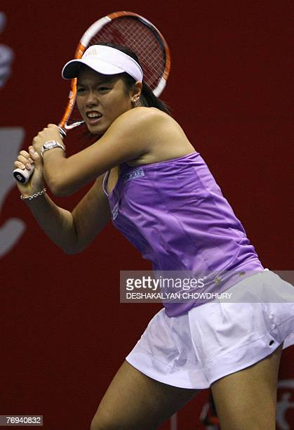 Tennis player Yung Jan Chan of Taipei plays a shot against Daniela Hantuchova of Slovakia during a quarter final round match of the Sunfeast Open...