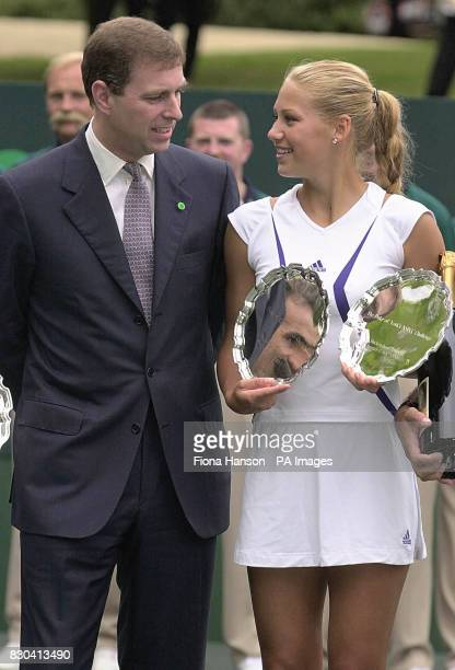 Tennis playerAnna Kournikova stood with the Duke of York while holding the trophy she won with Henri Leconte for a mixed doubles match during the...