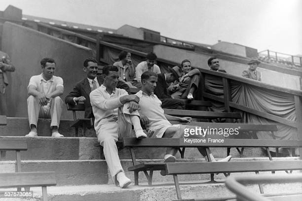 Tennis players Desmastell and Austin sat in the stands at Roland Garros in anticipation of the interzone final EnglandUnited States of the Davis Cup...