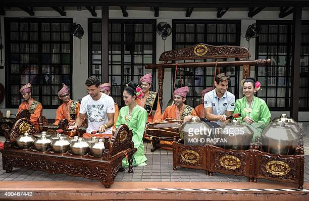 Tennis players Grigor Dimitrov of Bulgaria and David Ferrer of Spain play a Malaysian traditional musical instrument called the 'gamelan' during a...