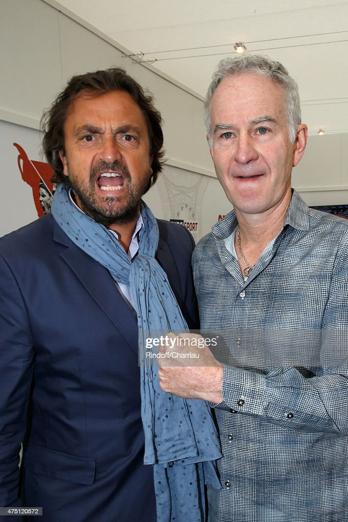 Tennis Players Henri Leconte and John McEnroe attend the 2015 Roland Garros French Tennis Open - Day Six, on May 29, 2015 in Paris, France.