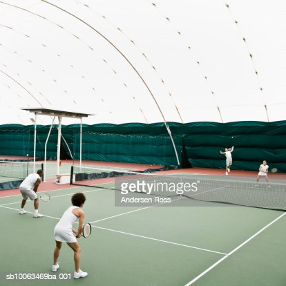 Tennis players in indoor tennis court, elevated view : Stock Photo