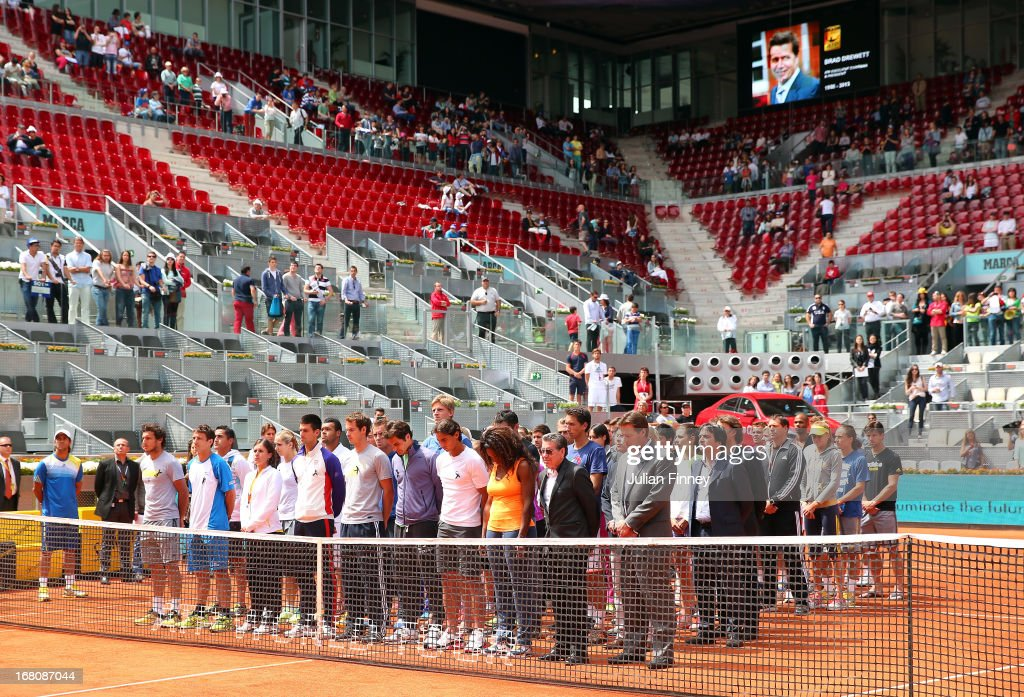Tennis players including Novak Djokovic, Andy Murray, Roger Federer, Rafael Nadal and Serena Williams observe a moment of silence for Brad Drewett during day two of the Mutua Madrid Open tennis tournament at the Caja Magica on May 5, 2013 in Madrid, Spain. He was a former tour player who led the ATP as executive chairman and president since January 2012, died Friday after a battle with motor neurone disease. He was 54.