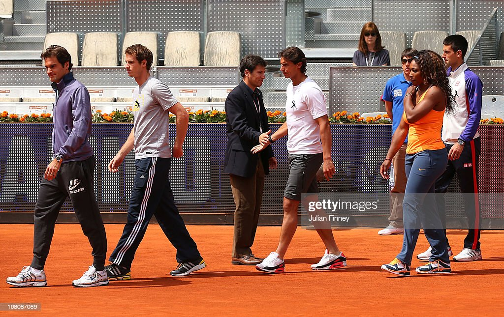 Tennis players including Novak Djokovic Andy Murray Roger Federer Rafael Nadal and Serena Williams arrive on court to observe a moment of silence for...