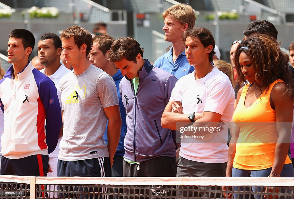 Tennis players including Novak Djokovic, Andy Murray, Roger Federer, Rafael Nadal and Serena Williams arrive on court to observe a moment of silence for Brad Drewett during day two of the Mutua Madrid Open tennis tournament at the Caja Magica on May 5, 2013 in Madrid, Spain. He was a former tour player who led the ATP as executive chairman and president since January 2012, died Friday after a battle with motor neurone disease. He was 54.