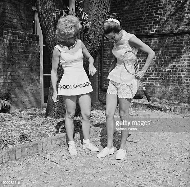 Tennis players Lea Pericoli of Italy and Carol Kalogeropoulos of Greece modeling Dacron outfits by English fashion designer Ted Tinling at a press...