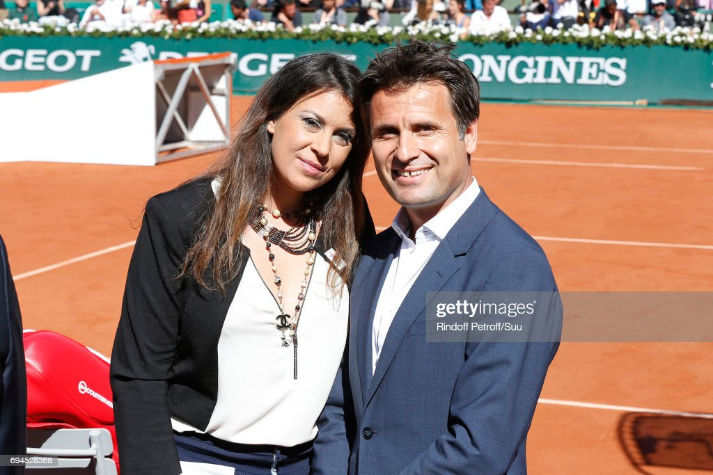 Tennis players Marion Bartoli and Arnaud Boetsch attend the Women Final of the 2017 French Tennis Open - Day Fourteen at Roland Garros on June 10, 2017 in Paris, France.
