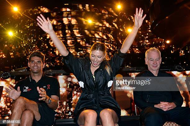 Tennis players Mark Philippoussis Maria Sharapova and former tennis player John McEnroe attend the live auction at the World TeamTennis Smash Hits...