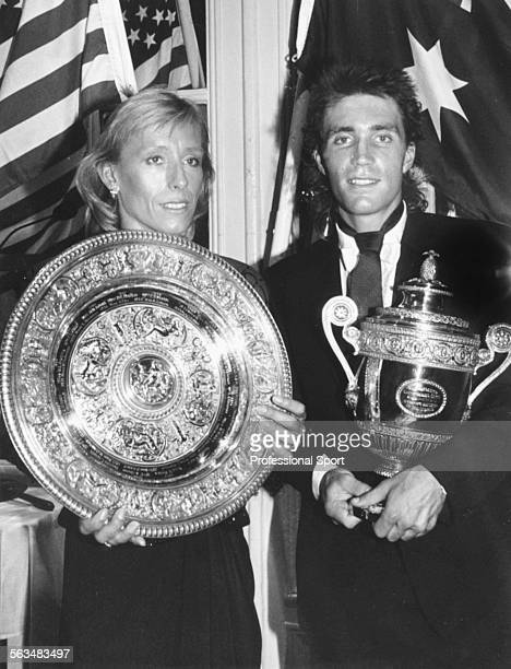 Tennis players Pat Cash and Martina Navratilova hold their Wimbledon Tennis Championship trophies at the Wimbledon Ball in London on July 5th 1987