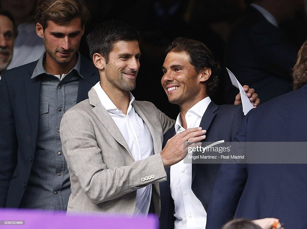 Tennis players Rafael Nadal (R) and Novak Djokovic during the UEFA Champions League Semi Final second leg match between Real Madrid and Manchester City FC at Estadio Santiago Bernabeu on May 4, 2016 in Madrid, Spain.