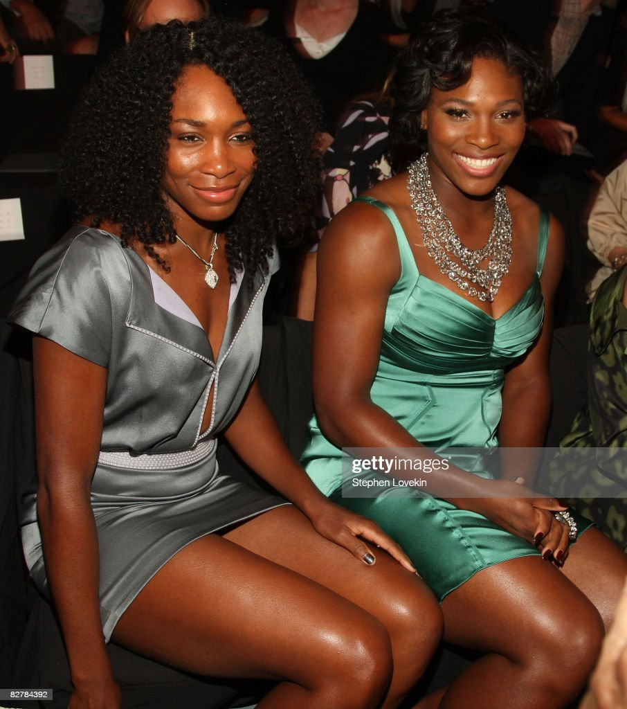 Tennis players Serena (R) and Venus Williams attend the Zac Posen Spring 2009 fashion show during Mercedes-Benz Fashion Week at The Tent, Bryant Park on September 11, 2008 in New York City.