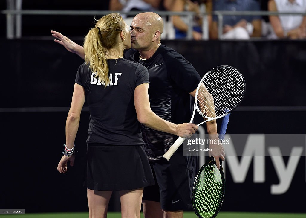 Tennis players Stefanie Graf (L) and her husband, <a gi-track='captionPersonalityLinkClicked' href=/galleries/search?phrase=Andre+Agassi&family=editorial&specificpeople=157607 ng-click='$event.stopPropagation()'>Andre Agassi</a>, react after scoring a point during play at the Mylan World TeamTennis Smash Hits charity tennis event at Caesars Palace on October 12, 2015 in Las Vegas, Nevada.