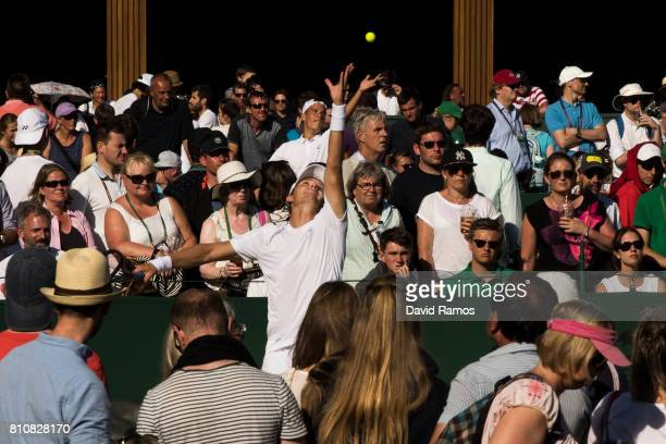 Tennis players take their serves on the outside courts on day six of the Wimbledon Lawn Tennis Championships at the All England Lawn Tennis and...