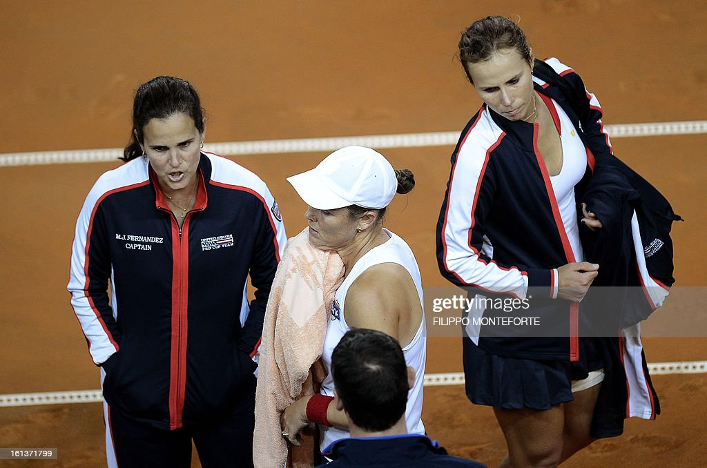 US tennis players Varvara Lepchenko (R) and Liezel Huber react with coach Mary Joe Fernandez (L) after losing to Italy's Sara Errani and Roberta Vinci during their Fed Cup tennis match in Rimini's 105 Stadium on February 10, 2013. The Italians won 6-2, 6-2 as Italy beats USA 3-2 going throught the semifinals.