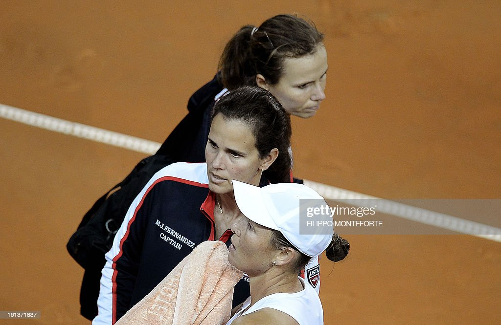 US tennis players Varvara Lepchenko (R) and Liezel Huber react with coach Mary Joe Fernandez (C) after losing to Italy's Sara Errani and Roberta Vinci during their Fed Cup tennis match in Rimini's 105 Stadium on February 10, 2013. The Italians won 6-2, 6-2 as Italy beats USA 3-2 going throught the semifinals.