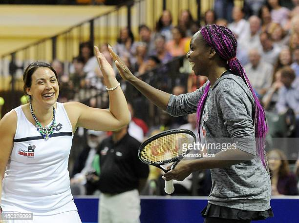 Tennis players Venus Williams and Marion Bartoli play during the Mylan World TeamTennis Matches at ESPN Wide World of Sports Complex on November 17...