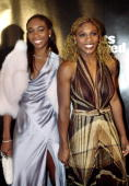 Tennis players Venus Williams left and Serena Williams attend the Sports Illustrated Sportsman of the Year 2000 awards ceremony December 12 2000 in...