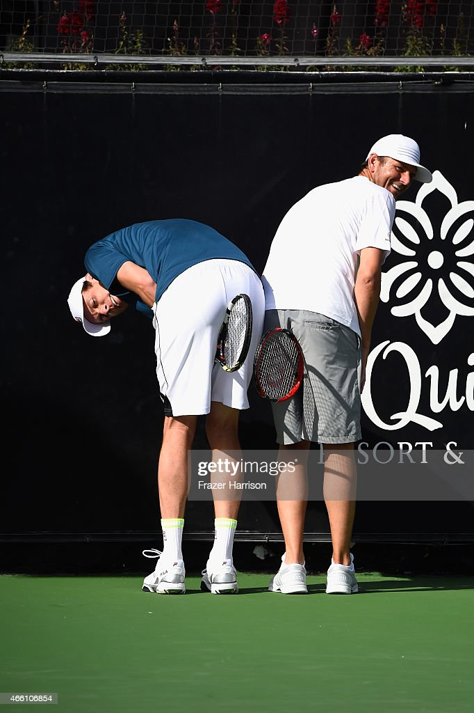 Tennis Pos <a gi-track='captionPersonalityLinkClicked' href=/galleries/search?phrase=Sam+Querrey&family=editorial&specificpeople=736491 ng-click='$event.stopPropagation()'>Sam Querrey</a> and <a gi-track='captionPersonalityLinkClicked' href=/galleries/search?phrase=Mardy+Fish&family=editorial&specificpeople=206218 ng-click='$event.stopPropagation()'>Mardy Fish</a> play at the 11th Annual Desert Smash Hosted By Will Ferrell Benefiting Cancer For College at La Quinta Resort and Club on March 10, 2015 in La Quinta, California.