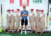 Tennis Pro Milos Raonic poses for a photo with an Emirates Cabin Crew for the Emirates USTA Serves DC Mayor and DC Parks and Recreation sponsored...