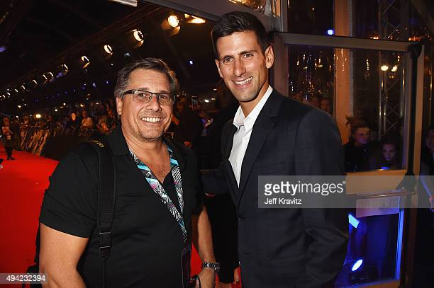 Tennis pro Novak Djokovic poses with photographer Kevin Mazur at the MTV EMA's 2015 at Mediolanum Forum on October 25 2015 in Milan Italy