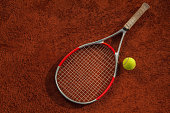 Close Up Of Tennis Racket And Ball On The Court