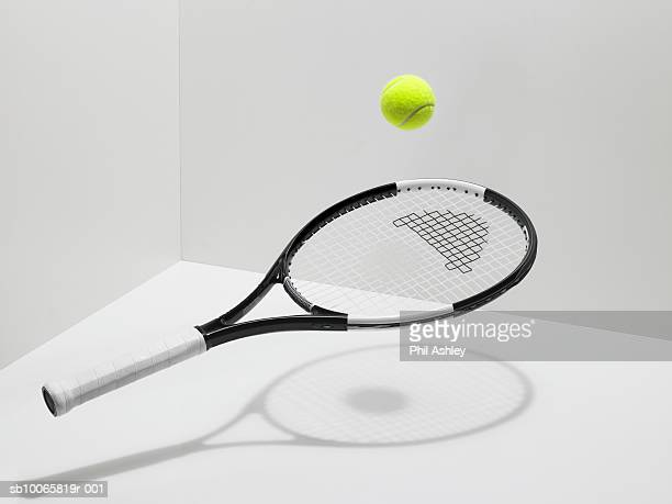 Tennis racket and ball on white background