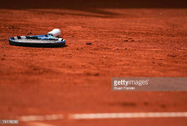 A tennis racket lays on the clay during day four of the Tennis Masters Series Hamburg at Rothenbaum Tennis Centre on May 17 2007 in Hamburg Germany