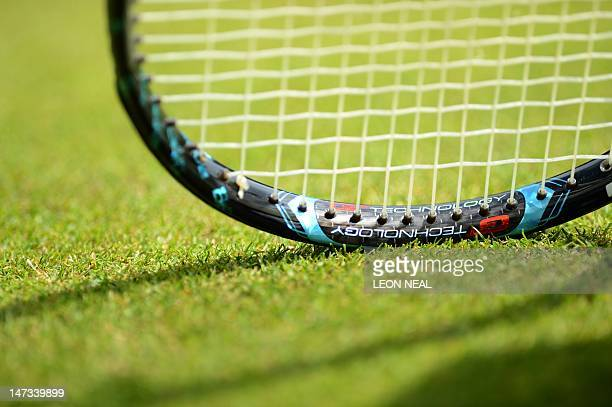 Tennis racket on the grass during the second round women's singles match between China's Zheng Jie and Canada's Aleksandra Wozniak on day four of the...