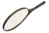 Tennis racket of brown color on a white background