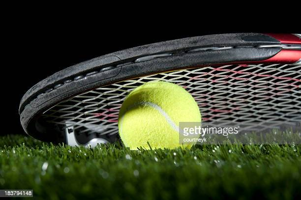 Tennis racquet and ball on the grass