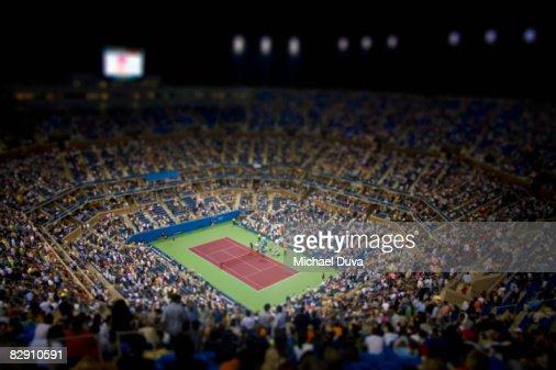 tennis stadium with spectators at night : Stock Photo