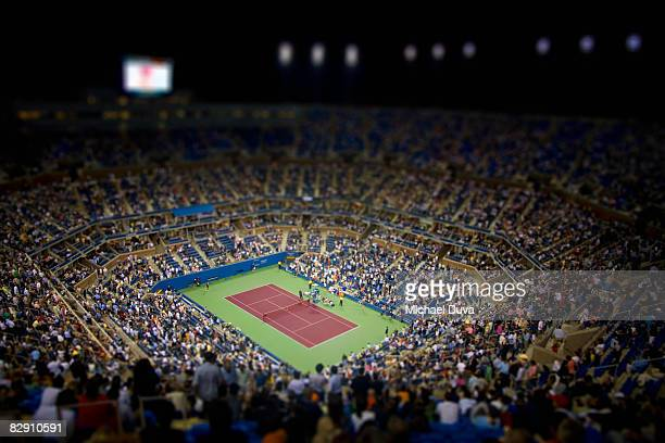 tennis stadium with spectators at night