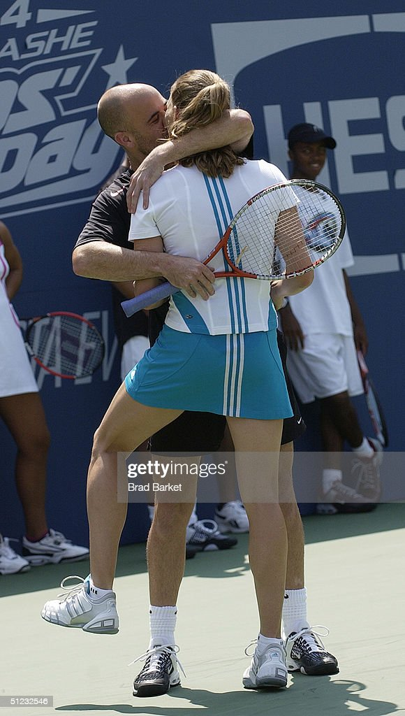 Tennis stars Andre Agassi and Steffi Graf attend the Arthur Ashe Day at the U.S. Open at Arthur Ashe Stadium on August 28, 2004 in New York.