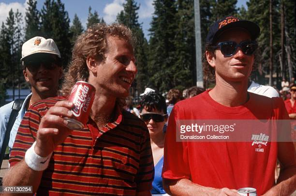 Tennis stars John McEnroe and Vitas Gerulaitis enjoy a refreshing Coca Cola at an exhibition softball game for Cerebral Palsy Research at the Mita...