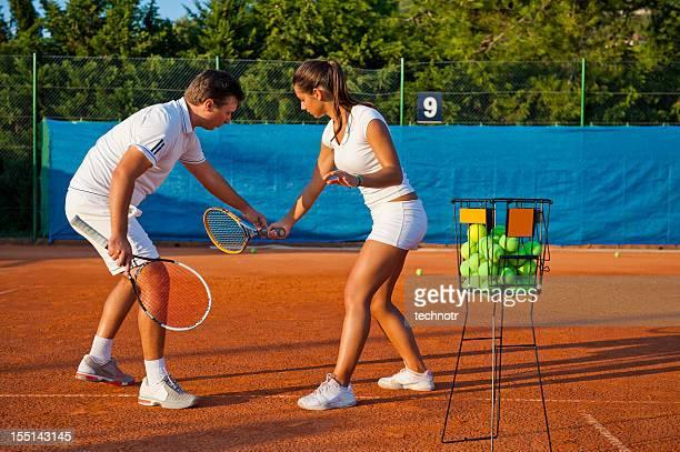 Tennis teacher giving lesson