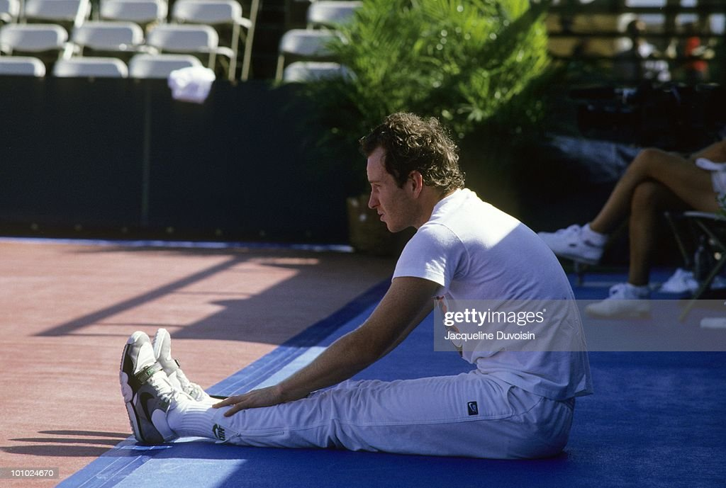 USA John McEnroe stretching before match at Palm Beach Polo & Country Club. West Palm Beach, FL