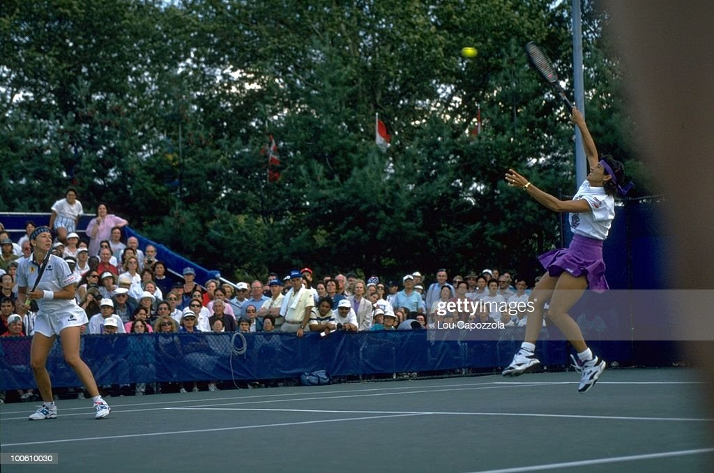 Belarus Natalia Zvereva and Puerto Rico Gigi Fernandez (pink skirt) in action during match at National Tennis Center. Flushing, NY 9/1/1994