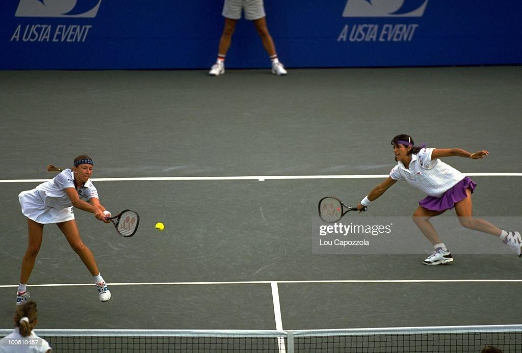Belarus Natalia Zvereva and Puerto Rico Gigi Fernandez (pink skirt) in action during match at National Tennis Center. Flushing, NY 9/10/1994