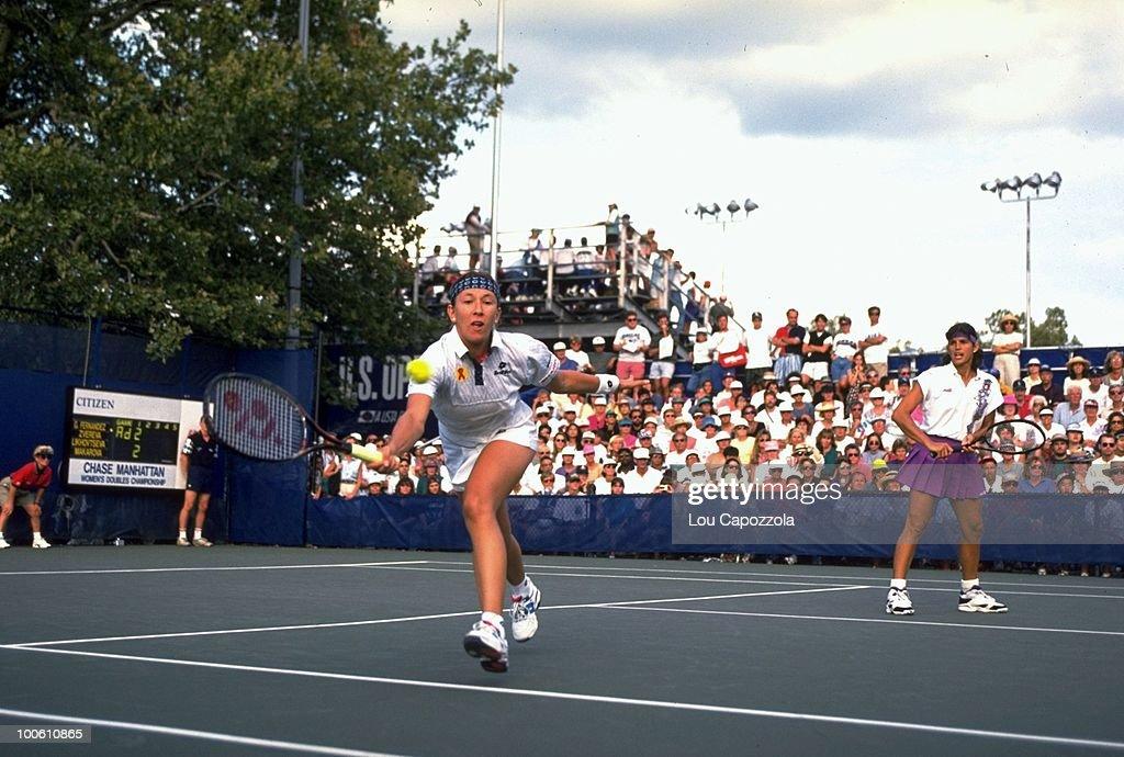 Belarus Natalia Zvereva and Puerto Rico Gigi Fernandez (pink skirt) in action during match at National Tennis Center. Flushing, NY 9/1/1994