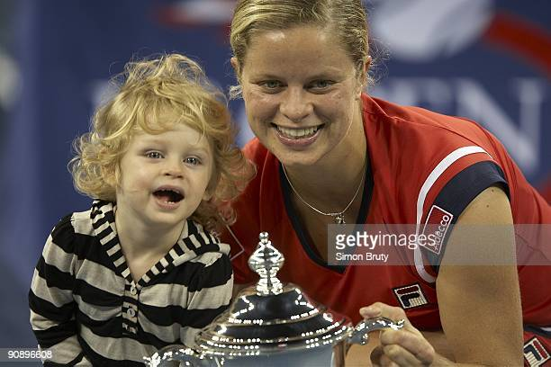 US Open Belgium Kim Clijsters victorious with daughter Jada and winner's trophy after winning Women's Final vs Denmark Caroline Wozniacki at National...