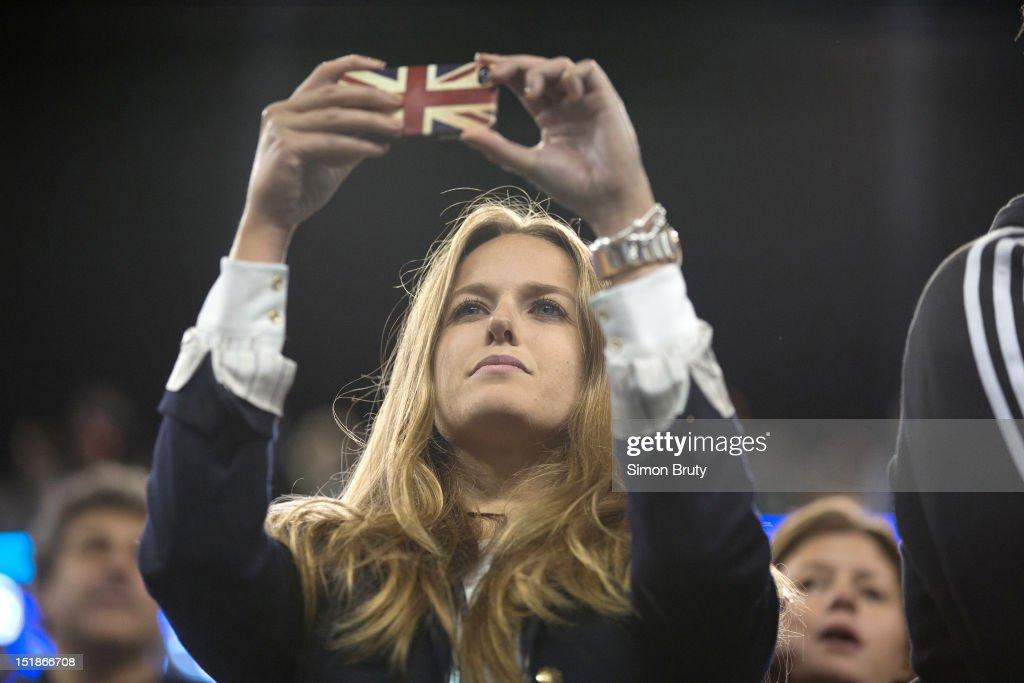 Closeup of Kim Sears, girlfriend of Great Britain Andy Murray, taking photo during Men's Final vs Serbia Novak Djokovic at BJK National Tennis Center. Simon Bruty F121 )