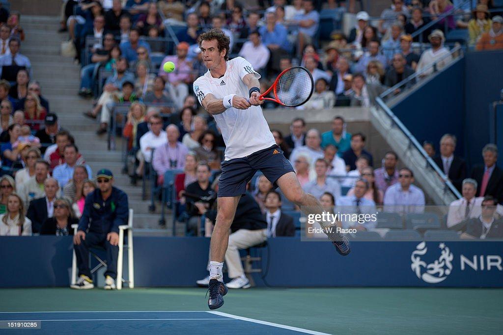 Great Britain Andy Murray in action vs Serbia Novak Djokovic during Men's Final at BJK National Tennis Center. Erick W. Rasco F102 )