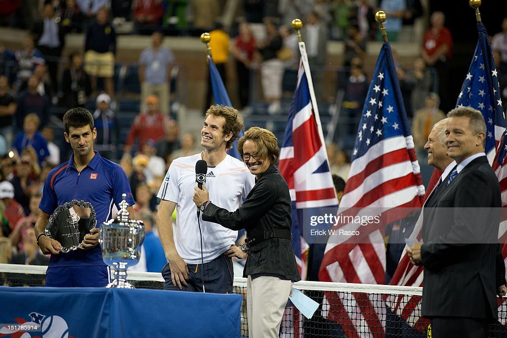 Great Britain Andy Murray victorious with CBS announcer Mary Carillo and US Open trophy after winning Men's Final vs Serbia Novak Djokovic at BJK National Tennis Center. View of Djokovic with runner up trophy. Erick W. Rasco F545 )
