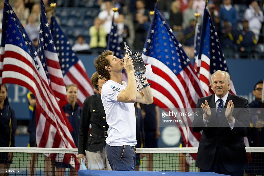Great Britain Andy Murray victorious with US Open trophy after winning Men's Final vs Serbia Novak Djokovic at BJK National Tennis Center. Simon Bruty F138 )