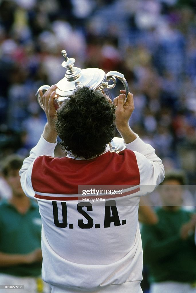 Rear view of USA John McEnroe victorious, kissing trophy after winning Men's Finals vs Czechoslovakia Ivan Lendl at National Tennis Center. Flushing, NY 9/9/1984